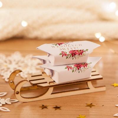 PREZENT świąteczny Sanki z krówkami Poinsecja